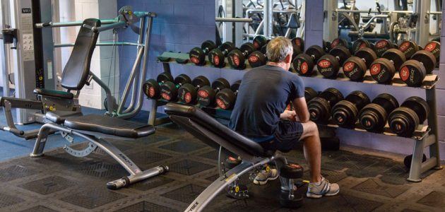 man doing weights in the gym