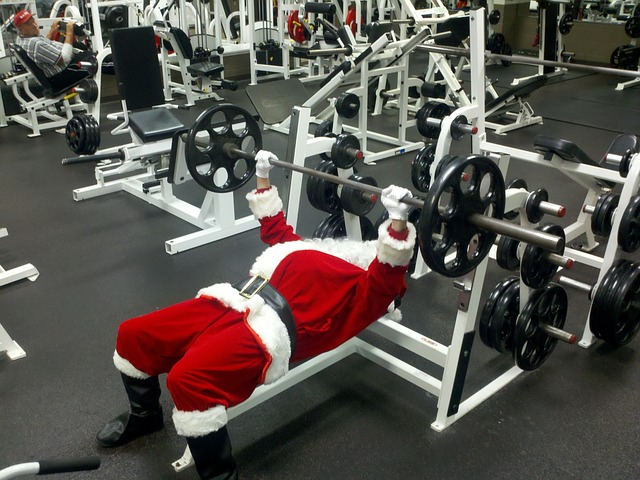 Santa Claus works out in gym