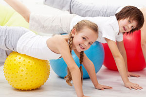 Children exercising - Swiss Ball