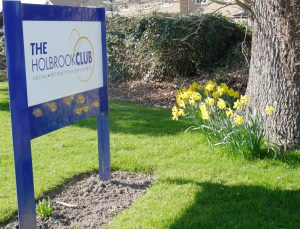 Signage with daffodils